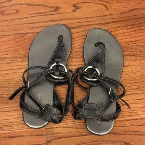 Black sandals with silver ring
